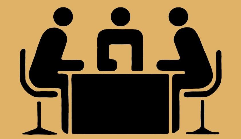 men at table resolving a dispute