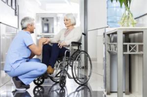 elderly woman in wheelchair talking to doctor - Elder Abuse Lawyer Image