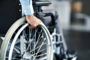 Closeup shot of a man sitting in a wheelchair - Disability Lawyer Image