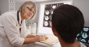 Doctor reviewing brain injury scans with patient in Halifax hospital