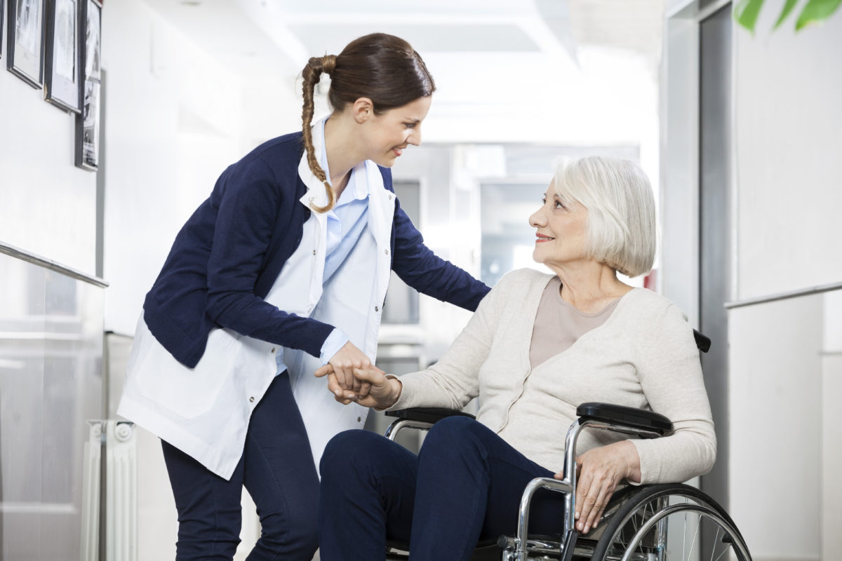 Old woman being helped by nurse