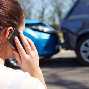a woman calling after a car accident